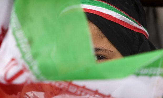 Girl waves an Iranian flag during a victory ceremony for President Mahmoud Ahmadinejad in central Tehran