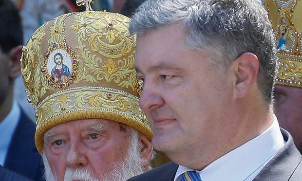 Wunsch nach mehr Eigenständigkeit. Patriarch Filaret und der ukrainische Präsident, Petro Poroschenko.