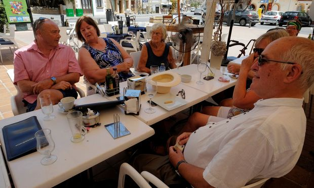 British residents discuss in a restaurant after Britain voted to leave the European Union in the EU Brexit referendum, in Javea near Alicante