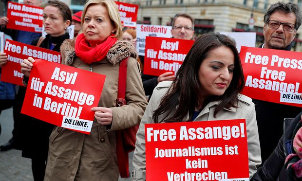 German MPs Gesine Loetzsch, Sevim Dagdelen and Diether Dehm from the left-wing party 'Die Linke' take part in a protest against the arrest of WikiLeaks founder Julian Assange, near the British embassy in Berlin