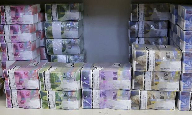 File photo of wads of Swiss franc banknotes at the GSA Austria company's headquarters in Vienna