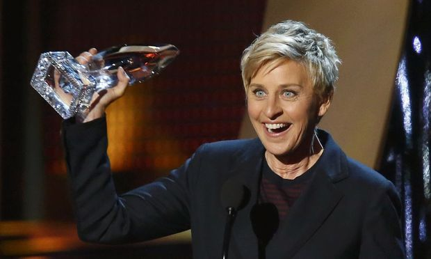 Ellen DeGeneres accepts the award for favorite daytime tv host for her show 'The Ellen DeGeneres Show' at the 2014 People's Choice Awards in Los Angeles
