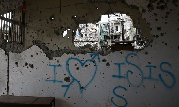 A graffiti that reads ´I love ISIS´ is seen in a damaged building in Marawi city