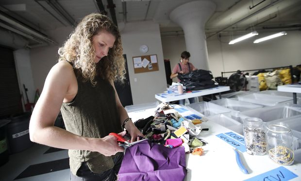 180919 NEW YORK Sept 19 2018 Staff members work in the space of Fabscrap a fabric recycl