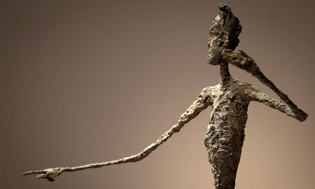 The top half of Alberto Giacometti's 'L'homme Au Doigt' (Pointing man) sculpture is pictured at Christie's Auction House in the Manhattan borough of New York