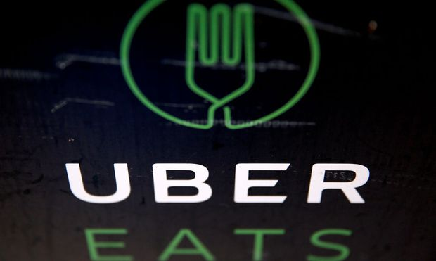 A detail of an UberEATS food delivery container is seen in London