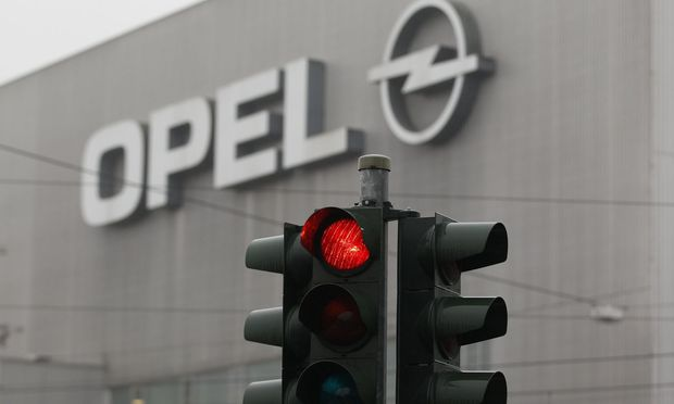 A traffic light is pictured in front of the Opel plant in Bochum
