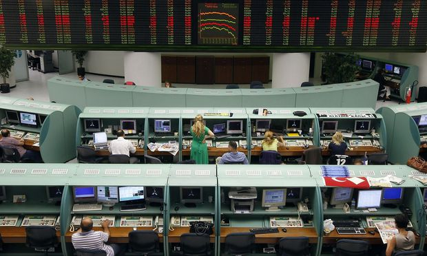 Traders work during the afternoon session at the Istanbul Stock Exchange