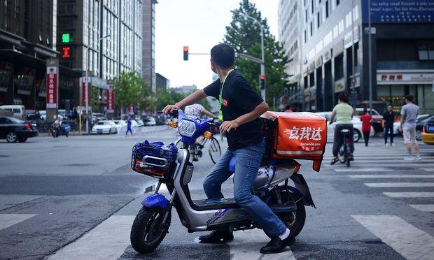Als Markt mit dem größten Zukunftspotential für Essenslieferdienste gilt China. / Bild: WANG ZHAO / AFP / picturedesk.co