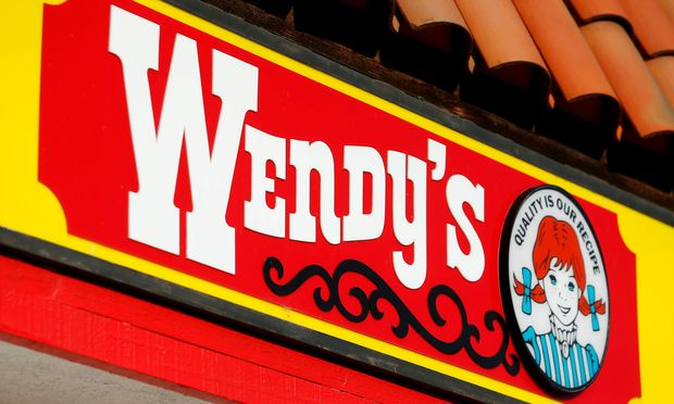 FILE PHOTO: A Wendy's sign and logo are shown at one of the company's restaurant in Encinitas, California