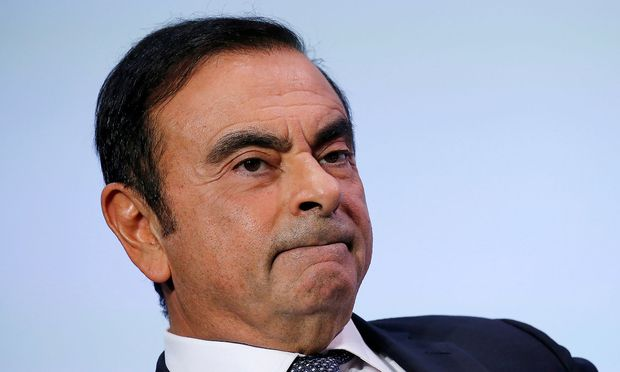 FILE PHOTO - Carlos Ghosn, Chairman and CEO of the Renault-Nissan-Mitsubishi Alliance, attends the Tomorrow In Motion event on the eve of press day at the Paris Auto Show