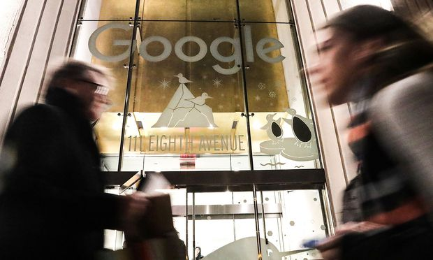 Pedestrians walk past Google headquarters in the Manhattan borough of New York City