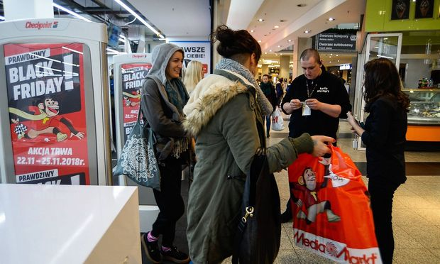 November 23 2018 Krakow Poland A woman seen exiting from the MediaMarkt shop during the Black