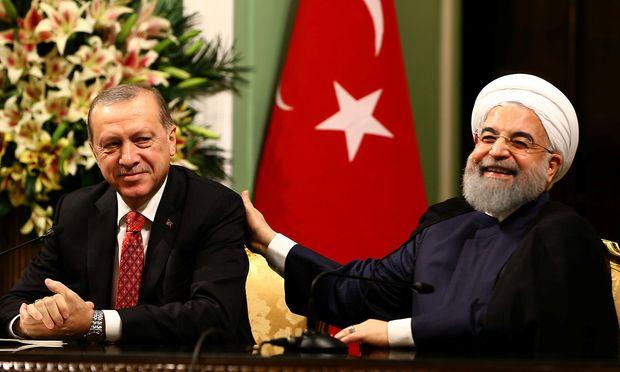 Der türkische Präsident Erdogan und Präsident Rouhani.