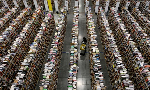 FILE PHOTO: A Worker gathers items for delivery at Amazon's distribution center in Phoenix