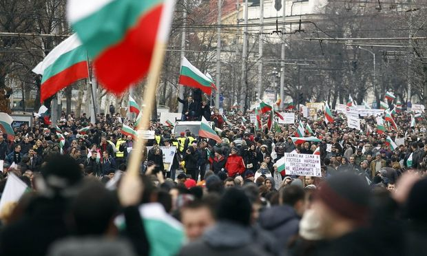 Thousands of demonstrators march on a street during a protest against high utility bills and monopolies in the energy sector in Sofia