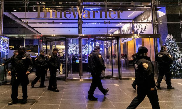 NYPD officers stand near the Time Warner Center Building after the building was evacuated due to a bomb threat, in the Manhattan borough of New York City