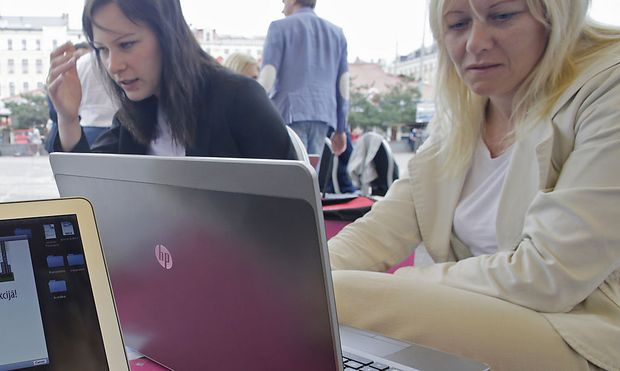 People use their laptops during ´Working everywhere´ event in Riga
