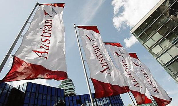 Austrian Airlines AUA flags flie in front of AUA's headquarters during a works council meeting at the