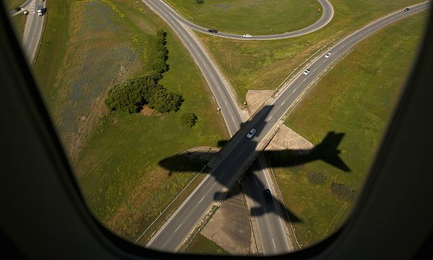 Air Force One casts a shadow upon its arrival n Austin, Texas