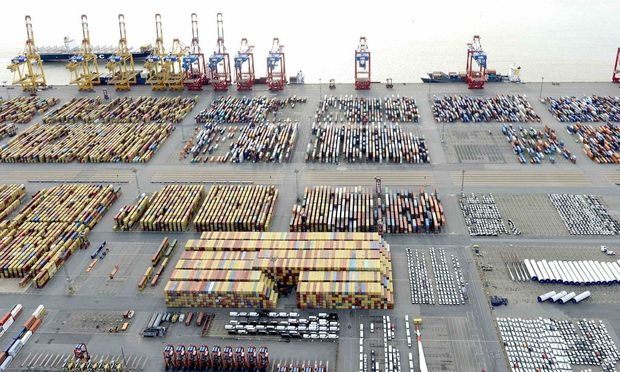 File photo of cars and containers at a shipping terminal in the harbour of the German northern town of Bremerhaven
