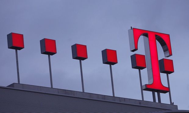The logo of Deutsche Telekom AG headquarters is pictured before the annual news conference in Bonn