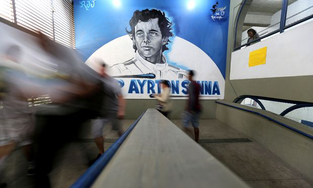 Brazilians arrive at the Ayrton Senna school to cast their votes in the presidential election, in Rio de Janeiro