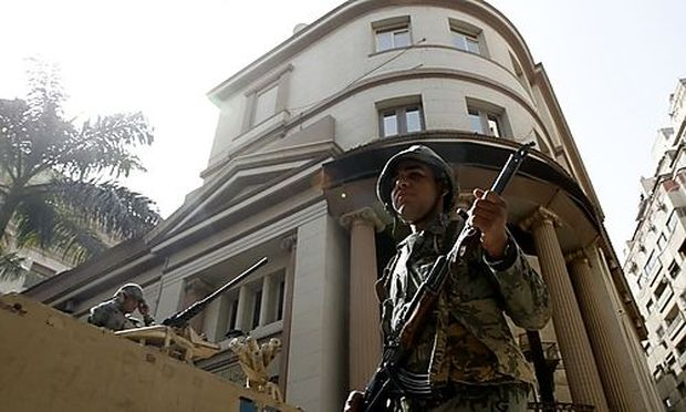 Egyptian Army soldiers guard the stock exchange in Cairo