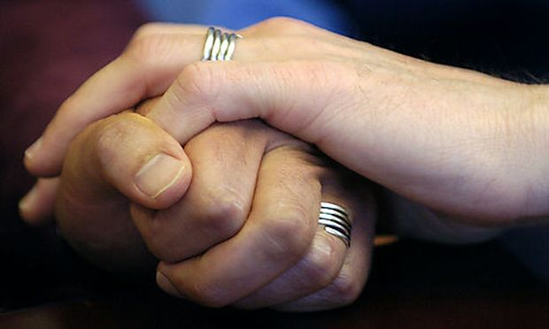 ***File*** Stuart Gaffney, left, and John Lewis, right, partners for 19 years, embrace hands with the