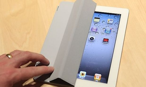 The iPad 2 with a Smart Cover is shown in use in the demonstration area after the iPad 2 launch durin