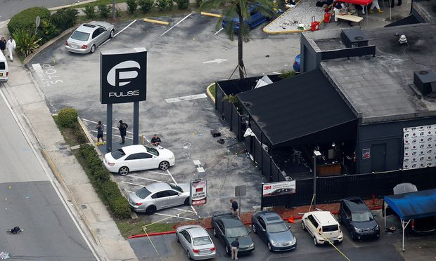 Investigators work the scene following a mass shooting at the Pulse gay nightclub in Orlando Florida