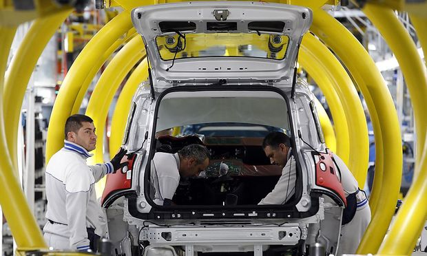 File photo of employees of Fiat SpA working on new  'Panda' car at the Fiat plant in Pomigliano D'Arco