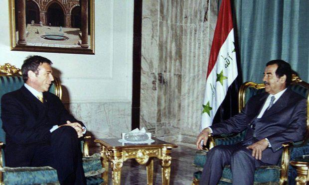 Iraqi Pesident Saddam Hussein (R) receives de facto leader of Austria´s Freedom Party Austria´s Joer..