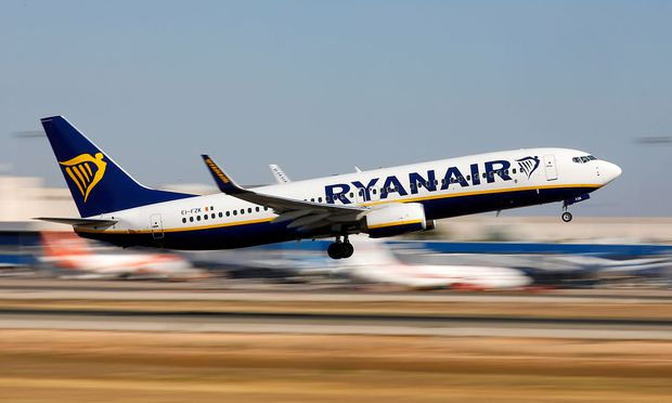 FILE PHOTO: A Ryanair Boeing 737 plane takes off from Palma de Mallorca airport in Palma de Mallorca