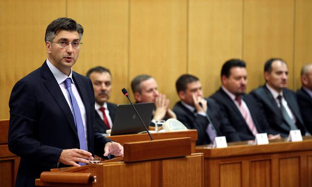 Croatia´s PM-designate Andrej Plenkovic speaks in the parliament before the government is approved in Zagreb