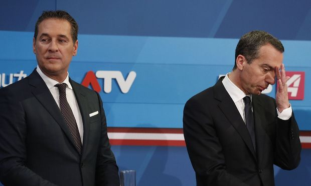 Heinz-Christian Strache and Christian Kern attend the TV debate after Austria´s general election in Vienna