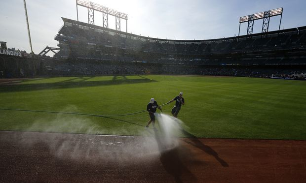 Grounds crew prepare the field ahead of the semi-final World Baseball Classic game between Japan and Puerto Rico in San Francisco