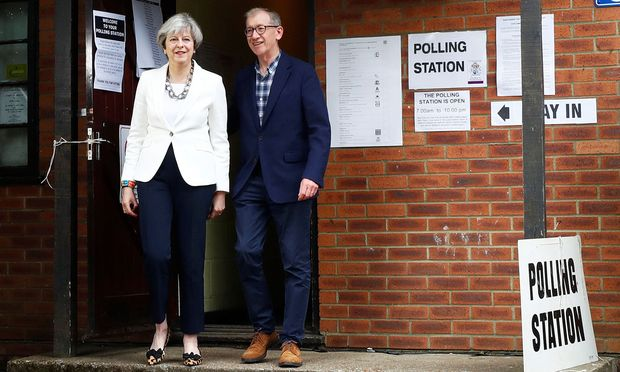 Britain´s Primer Minister Theresa May and her husband Philip leave a polling station in Sonning