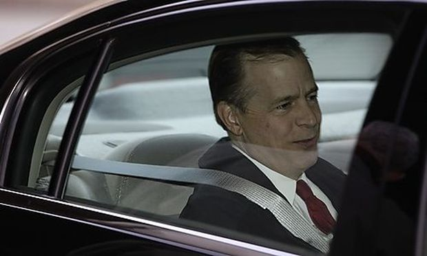 U.S. Special Representative for North Korea Glyn Davies sits in a car as he leaves a hotel in Beijing