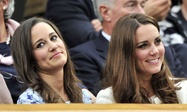 Britain´s Catherine, Duchess of Cambridge sits with her sister Pippa Middleton on Centre Court at the Wimbledon Tennis Championships in London