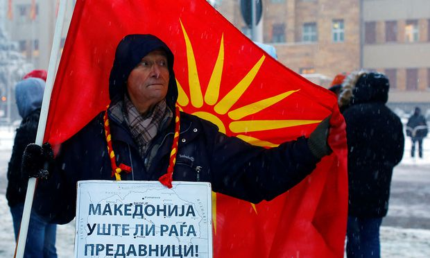 Supporters of the movement boycotting the deal with neighbouring Greece to change the country's name to the Republic of North Macedonia protest in front of the parliament building in Skopje