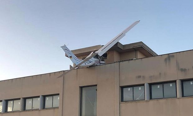 A small plane is seen after it crashed into a building in Badia del Valles, near Barcelona