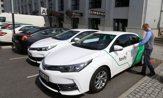 A Taxify driver enters his car in Tallinn