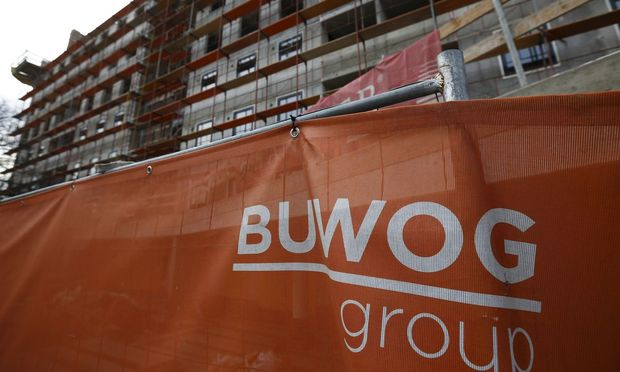 File photo of the logo of Austrian real estate agent BUWOG seen in front of one of their construction sites in Vienna