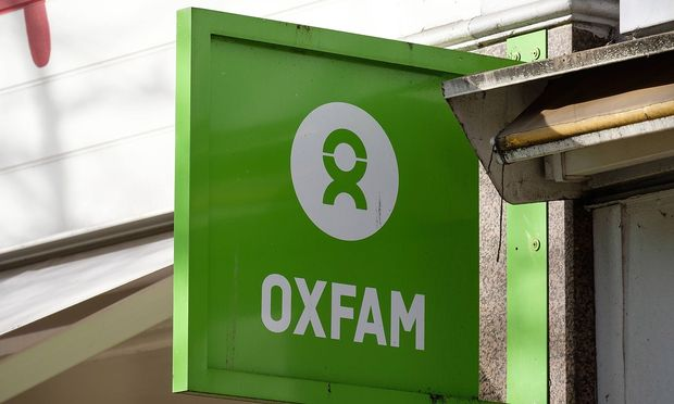 February 12 2018 London London UK An Oxfam charity store in Ealing Oxfam is engulfed in a sc