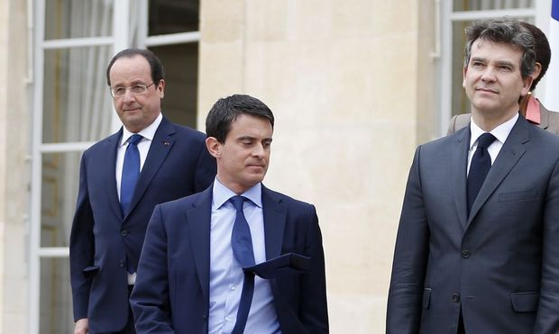File photo of France's President Hollande arrives to take his place with ministers for the traditional government family photo at the Elysee Palace in Paris