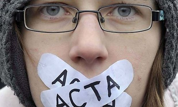 Demonstrators protest against signing of the international copyright agreement ACTA by the Slovenian