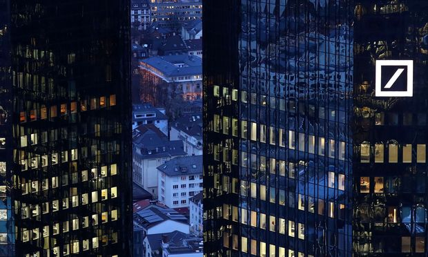 FILE PHOTO: The headquarters of Germany´s Deutsche Bank are seen early evening in Frankfurt