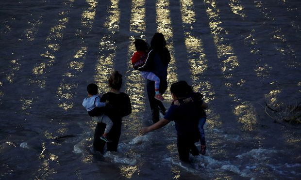 Migrants from Central America cross the Rio Bravo river to enter illegally into the United States as seen from Ciudad Juarez