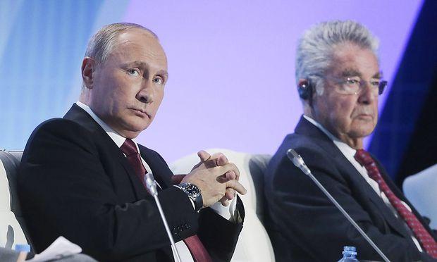 SOCHI RUSSIA OCTOBER 27 2016 Russia s President Vladimir Putin L and Austria s former Preside